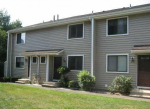 Townhouse end unit with nicely landscaped lawn and shrubs in the Jefferson Woods Branford CT condo complex.