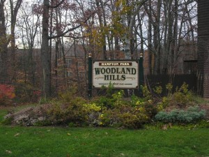 sign to the entrance of woodland hills condos