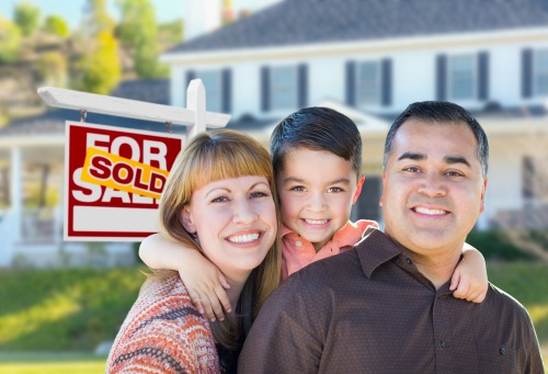 family in front of home sold